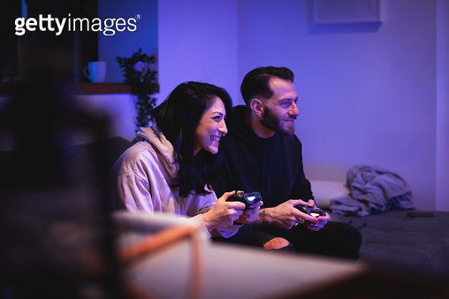 Couple Playing Videogames - gettyimageskorea