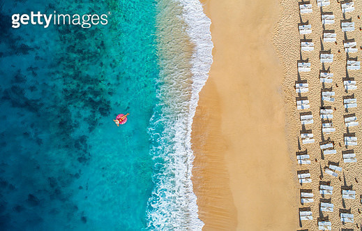 Aerial view of swimming in clear turquoise water with swimming float. Mediterranean sea. - gettyimageskorea