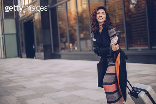 Young woman with suitcase - gettyimageskorea