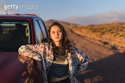 Young Caucasian woman standing near pickup car in   Atacama desert in Chile - gettyimageskorea