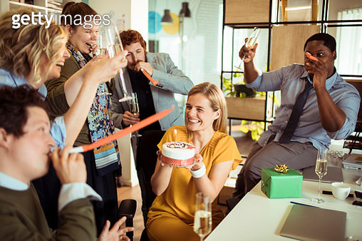 Close up of a group of designers having a birthday party at their office - gettyimageskorea