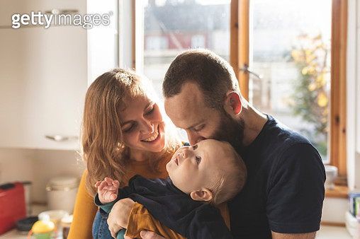 Happy affectionate family in the kitchen at home - gettyimageskorea