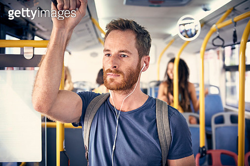 Portrait of young man with headphones in a bus - gettyimageskorea
