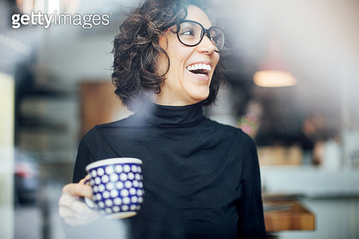 Cheerful businesswoman at coffee shop - gettyimageskorea