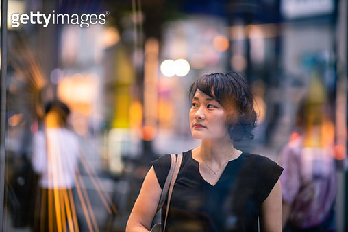 Young business woman shopping after work - gettyimageskorea