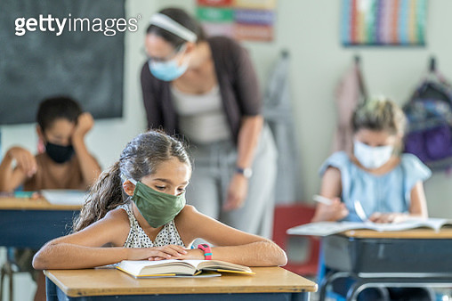 Young female student wearing a protective face mask in the classroom - gettyimageskorea