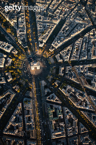 Aerial flying over the Arc de Triomphe in Paris France, looking directly down at the monument, buildings, streets going out from the Arc, and morning commuter traffic, cars and trucks, view from a helicopter on a beautiful clear morning at sunrise - gettyimageskorea