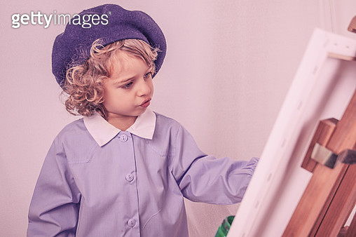 Little Boy Painting on a Canvas - gettyimageskorea