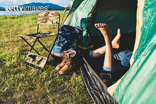Low Section Of Woman Relaxing In Tent - gettyimageskorea