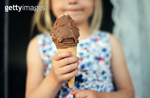A girl with an ice cream - gettyimageskorea