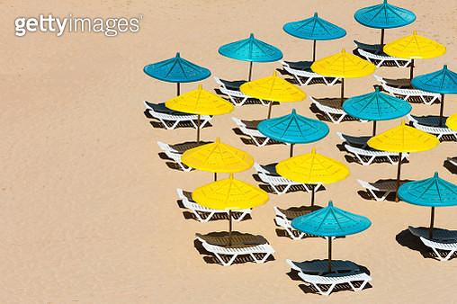 Beach chears and umbrellas on the beach - gettyimageskorea