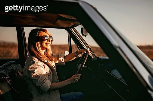 Woman driving in old timer car - gettyimageskorea