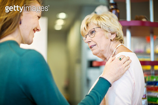 Woman talking with her mother at pharmacy - gettyimageskorea