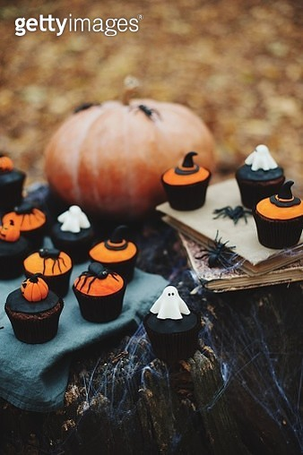 Close-Up Of Cupcakes And Pumpkin On Table During Halloween Celebration - gettyimageskorea