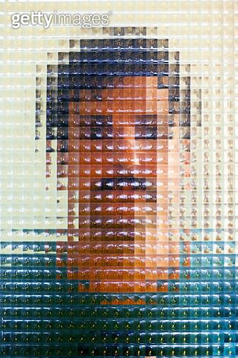 Man behing distorted glass - gettyimageskorea