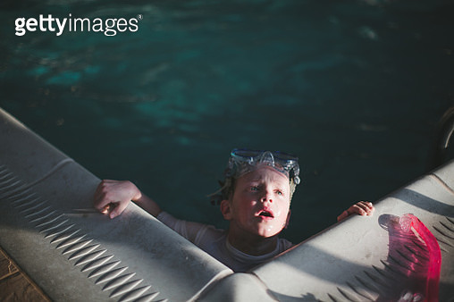 Boy in Swimming Pool - gettyimageskorea