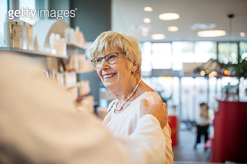 Elderly customer being assisted by pharmacist - gettyimageskorea