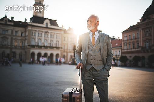 Serious senior businessman on a business travel - gettyimageskorea