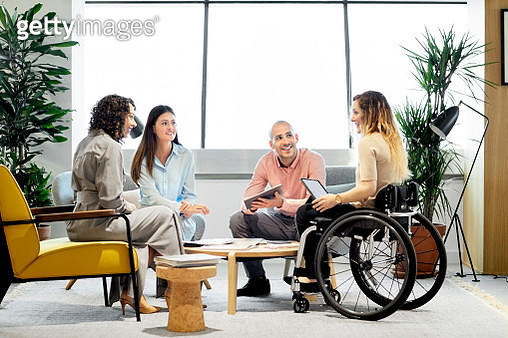 Disabled professional with coworkers in meeting - gettyimageskorea