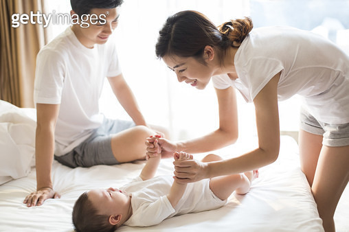 Happy young Chinese family - gettyimageskorea