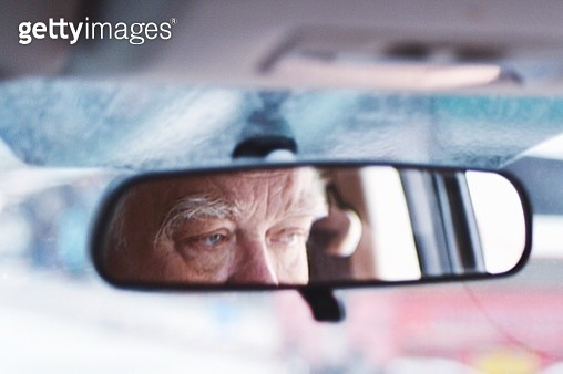 Senior Man Reflecting On Rear-View Mirror In Car - gettyimageskorea