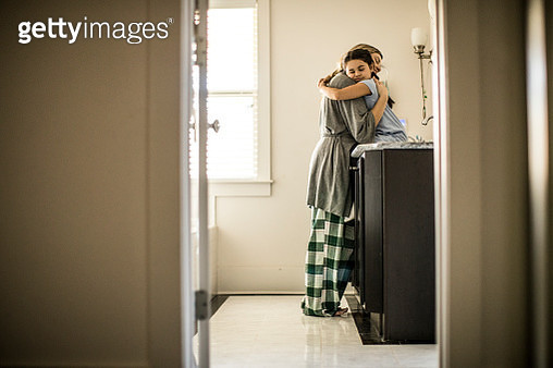 Mother and daughter (7yrs) hugging - gettyimageskorea