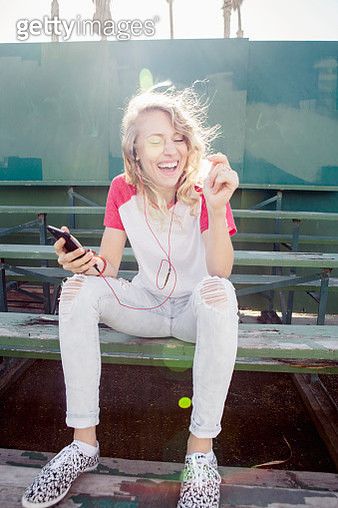 Young woman listening to music on smartphone - gettyimageskorea