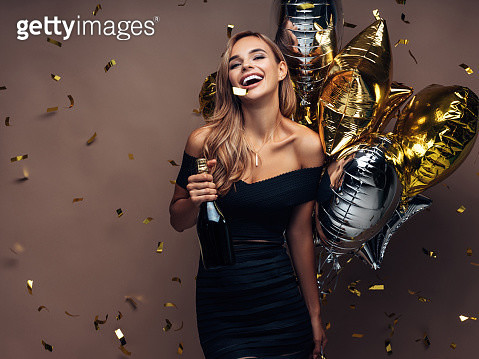 Beautiful girl with gold and silver balloons is dancing at the club - gettyimageskorea