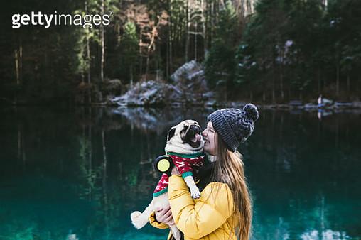 Woman and dog walking at lake Blausee in Switzerland - gettyimageskorea