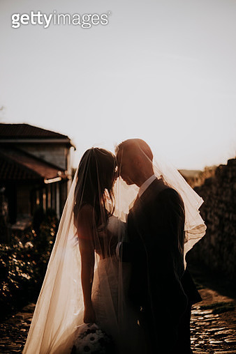 The bride and groom on their most important day in your life. They love each other, holding hands, kissing. It is the wedding dress and he in formal suits. They are ready to say to each other YES. - gettyimageskorea