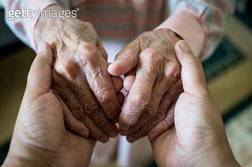 Young woman holding elder hands - gettyimageskorea
