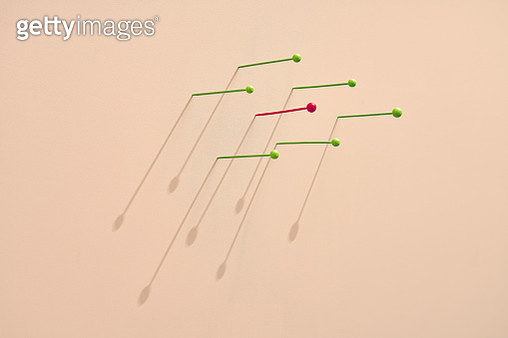 map pins where one red colored is standing out from the green crowd - gettyimageskorea