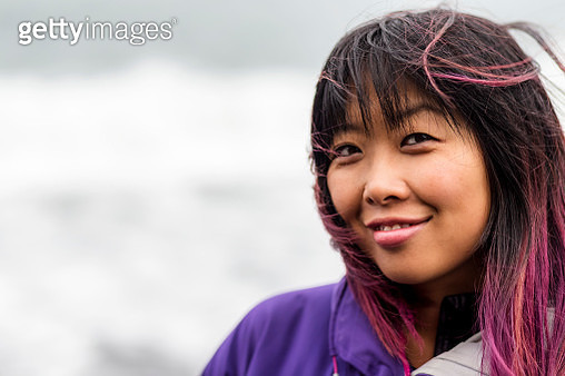 Close-up portrait of a Filipino woman with dyed pink hair - gettyimageskorea