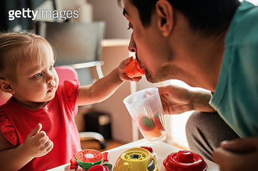 Little girl playing together with her father at home - gettyimageskorea
