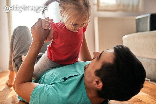 Little girl playing with her father at home - gettyimageskorea