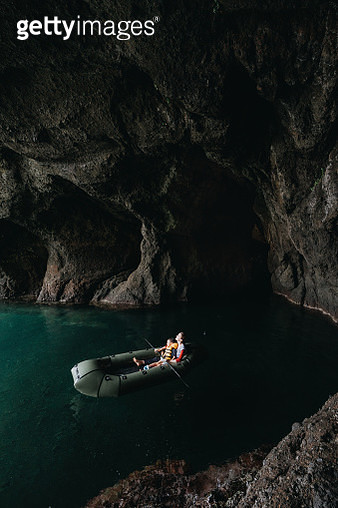 Mother and child having adventure with packraft boat inside sea cave - gettyimageskorea