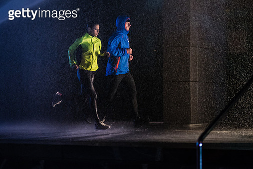 Man and woman jogging in city - gettyimageskorea
