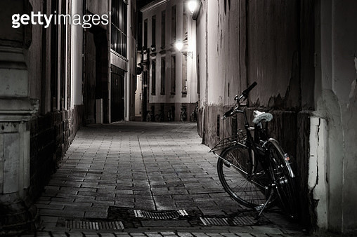 Empty lonely street with parked bikes at night, Strasbourg, France - gettyimageskorea