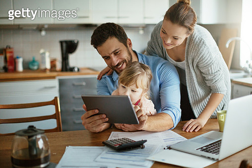 Young family enjoying time home - gettyimageskorea