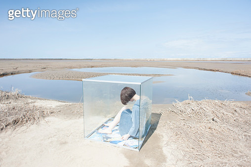 Woman in glass cube - gettyimageskorea