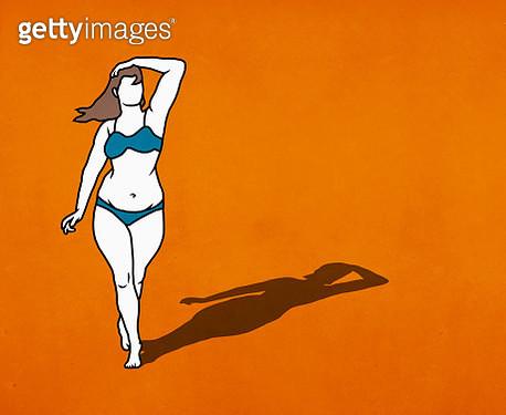 Portrait confident overweight woman in bikini on orange background - gettyimageskorea
