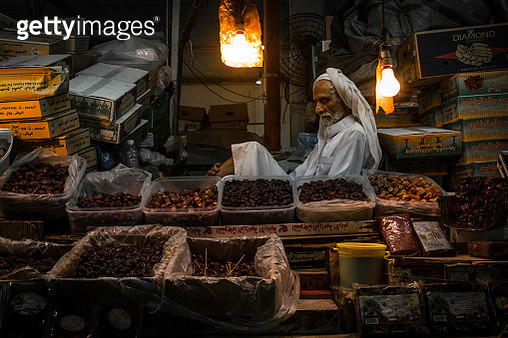 Vendor At Market Stall - gettyimageskorea