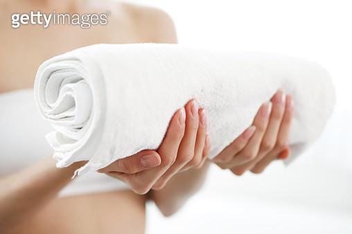 Woman holding towel - gettyimageskorea