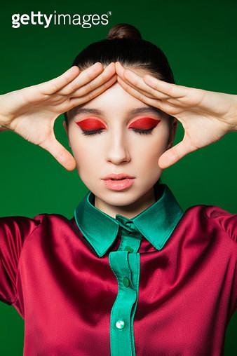 Model with makeup posing with hands - gettyimageskorea
