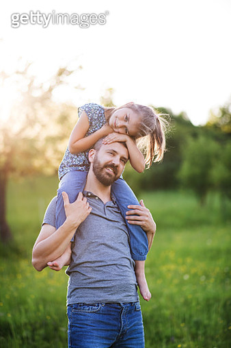 Father Giving Small Daughter A Piggyback Ride In Spring Nature. - gettyimageskorea