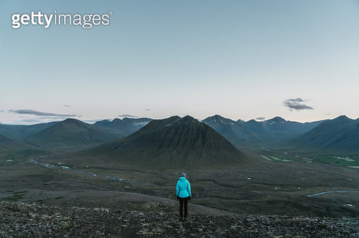 Woman looking at  volcanic landscape in Iceland - gettyimageskorea