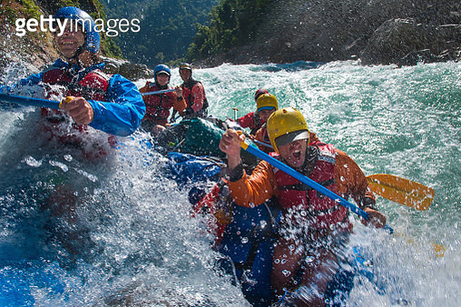Rafters get splashed as they go through some big rapids on the Karnali river in Nepal - gettyimageskorea