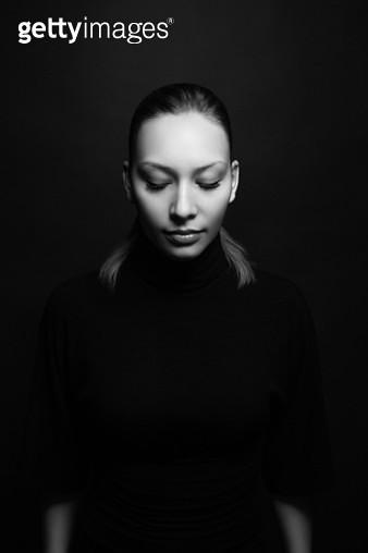 Portrait of woman on black background - gettyimageskorea