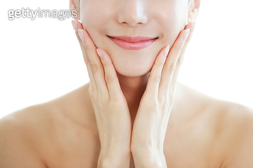 Woman with Hands on Face - gettyimageskorea