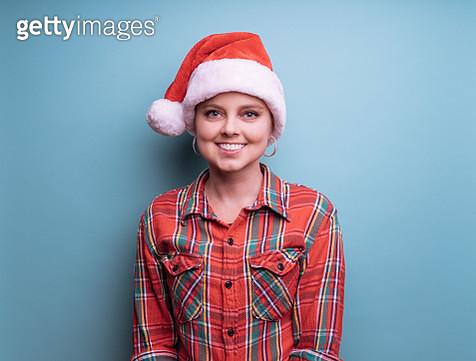 Model wearing Santa Hat and plaid shirt - gettyimageskorea